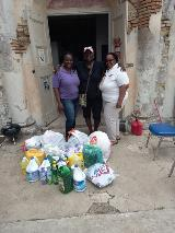 VITEMA staff members collect supplies to donate to a local organization, in partnership with the Collective Collaboration